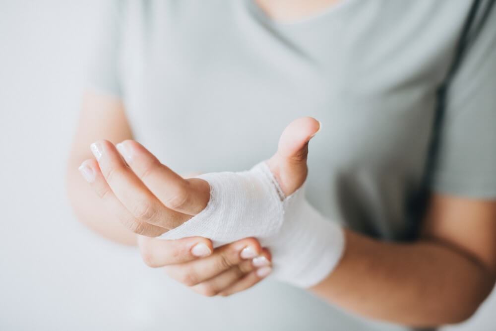 First-aid bandage close up on hands